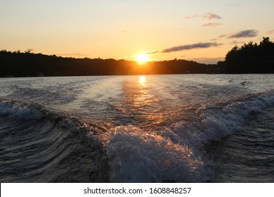 View from boat as the sun sets on Muskoka Lake in Canada