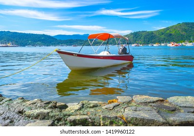 View of boats at the canal of the historic town  in Paraty, Rio de Janeiro state, Brazil. Sunny day in Paraty. Paraty is the colonial city listed Unesco