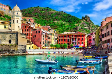 View of the boats and old Vernazza village, Cinque Terre, Italy. Architecture and landmark of Cinque Terre