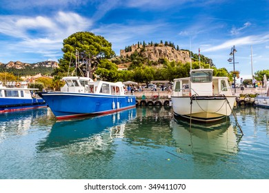 View Of Boats In The Port And Chateau Behind-Cassis,France