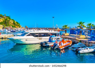 View with boats and yachts in the harbor of the old town of Antalya, Turkey. Tourist boats in the port of Antalya