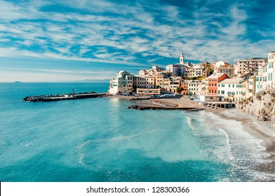 View of Bogliasco. Bogliasco is a ancient fishing village in Italy, Genoa, Liguria. Mediterranean Sea, sandy beach and architecture of Bogliasco town. Cloudy blue sky sunny day idyllic scenery, winter