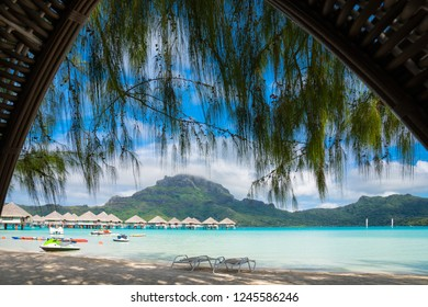 View of Bora Bora beach with turquoise water from inside of a beach tent, Tahiti