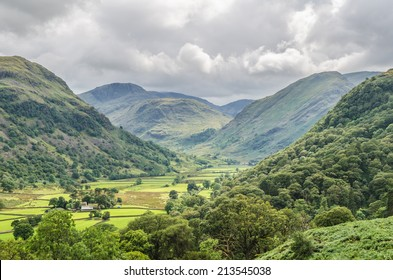 View of Borrowdale in the Lake District with green fields in the summertime
