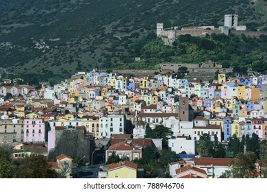 View of Bosa, a little town on the river Temo, with colorful houses and the Castle Malaspina in pier. Bridge, clouds, sky, castle walls, Bosa, Sardinia, Italy