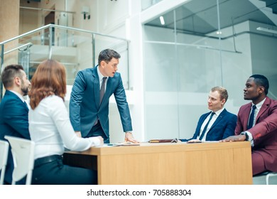 View of a Boss heading a business reunion with partners