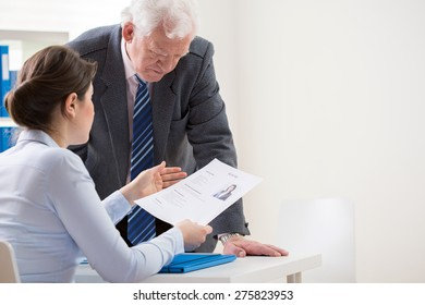 View of boss talking with job candidate