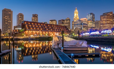 View of the Boston Harbor and Financial District at night showcasing its mix of contemporary and historic architecture.