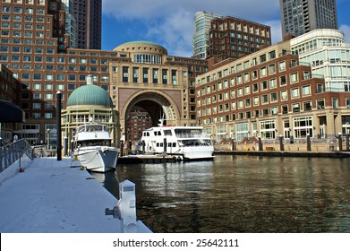 view of boston harbor and rowes wharf and skyscraper buildings in boston massachusetts with ships