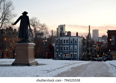 View of Boston, MA skyline from the Bunker Hill Monument grounds at sunset
