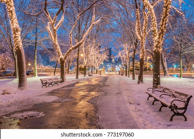 View of Boston in Massachusetts, USA at Commonwealth Avenue with its Christmas lights just after the first snow fall of the year.