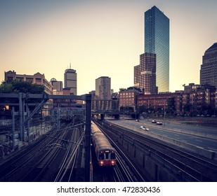 View of Boston in Massachusetts, USA showcasing its mix of modern and historic architecture in a cross processed photo.