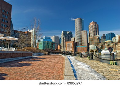 View of Boston skyline and rowe's wharf with skyscraper buildings during winter