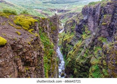 View of Botnsa river among rocks in Iceland