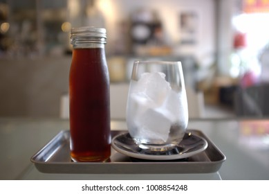View of a bottle of cold brew coffee and ice in glass