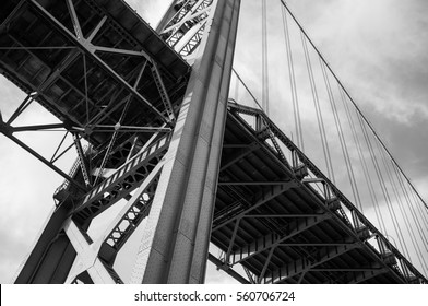 A view from bottom of the Ambassador Bridge, a suspension bridge.  located in Windsor, Ontario. and Detroit City, Michigan.   Black and White.