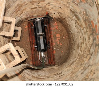 View of the bottom of a manhole with camera robot ready for use