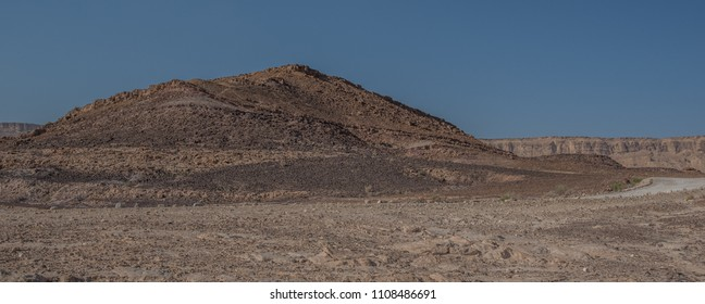 View from from the bottom of the Ramon Crater (Makhtesh Ramon) towards its northern vertical rim, Ramon Nature reserve, Mitzpe Ramon, Beersheba, Negev desert, Israel