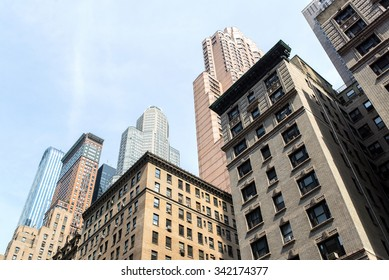 view from bottom of some buildings in the midtown of manhattan in new-york city