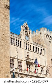 View from the bottom to the top of the town hall and the Clock of Narbonne in southern France