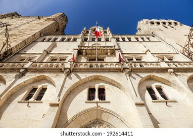 View from the bottom to the top of the town hall of Narbonne in southern France