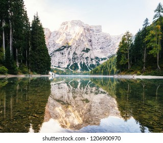 View of Braies Lake with reflection in Dolomites mountains in the morning, Pragser Wildsee, South Tyrol, Italy