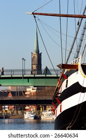 View of Bremen city Germany. Ship river bridge and church