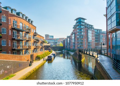 View of brick buildings alongside a water channel in the central Birmingham, England