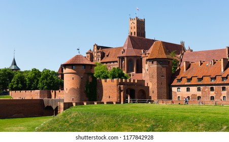 View of brick Gothic Castle of Teutonic Knights located in ancient Polish town of Malbork