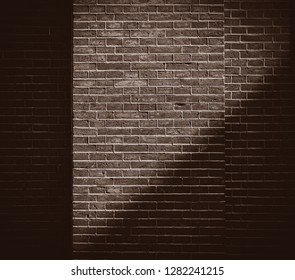 View at brick wall with shadow. Real hosue brick wall Image in sepia color style
