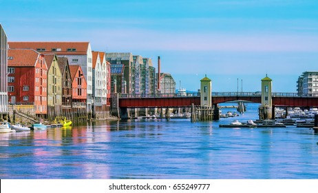 The view of the bridge Bakke Bru, the river Nidelva  and historical old timber buildings in Trondheim, Norway
