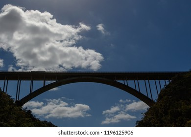 The view of the bridge with the clouds high in the sky