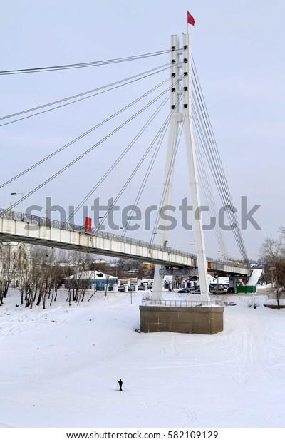 View of the bridge fallen in love in Tyumen in the winter, Russia. February 17, 2017