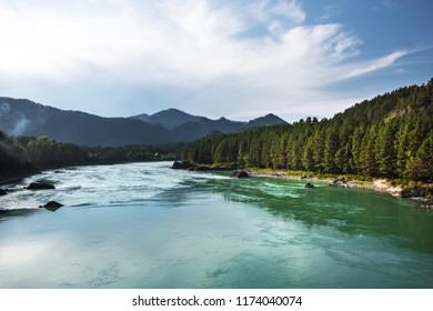 The view from the bridge at the Katun river, the village of Askat and mountains. Mountain Altai, Southern Siberia, Russia