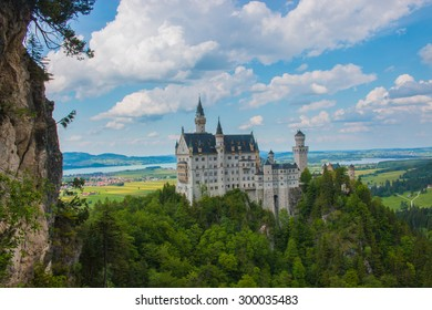 View from the bridge at the medieval castle neuschwanstein. Around the blue sky and the high Alps. Beautiful view of the castle. open landmark and background nature.