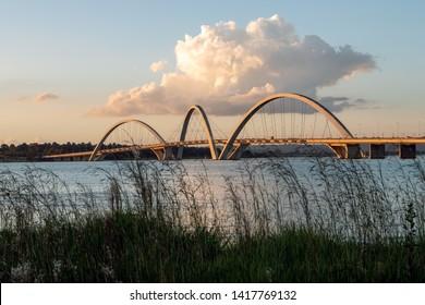 View of the bridge over the lake in the golden hour. JK bridge. Brasilia capital of Brazil. Sunset.