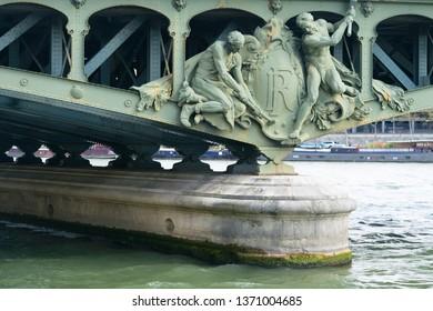 view of the bridge pillar with sculptures of Bir Hakeim bridge in Paris, France