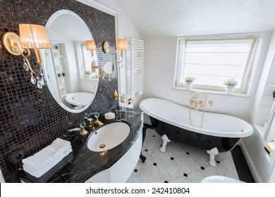 View of bright bathroom in baroque style