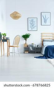 View of bright stylish bedroom in minimalist scandinavian flat