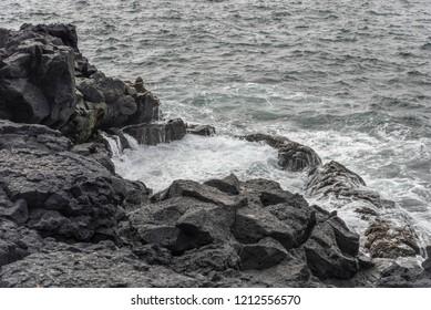 View of Brimketill Lava rock pool, Iceland.