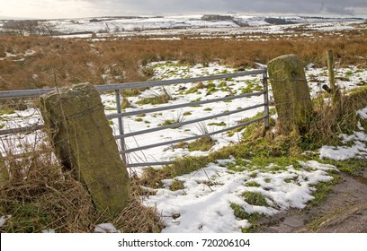 A view of a broken field gate on the moors above Wigan in the winter snow
