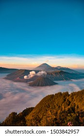 View Bromo area from Sunrise Point Penanjakan 1. The mountain at the front is Mount Batok. Bromo is located right behind. The center of the mountain which is hollow and smoky is its trademark.