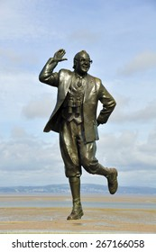 View of the bronze statue of comedian Eric Morecambe in his home town in Lancashire, UK.