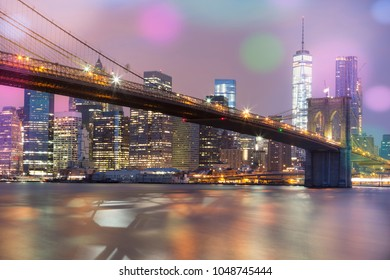 View of Brooklyn Bridge by night, NYC, special photographic processing.