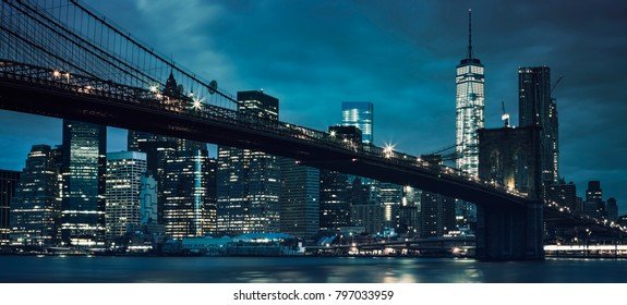 View of Brooklyn Bridge by night, NYC.