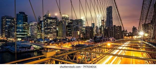 View of Brooklyn Bridge at sunset, NYC.