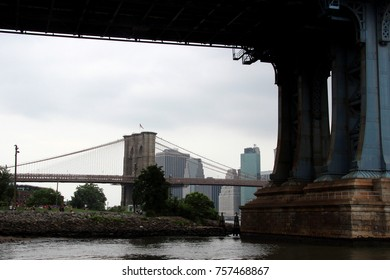 View of Brooklyn Bridge through Manhattan Bridge in NYC