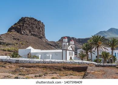 View of the building of the church Ermita Nuestra Sra. De las Nieves, Puerto las Nieves, Las Palmas, Spain. Copy space for text