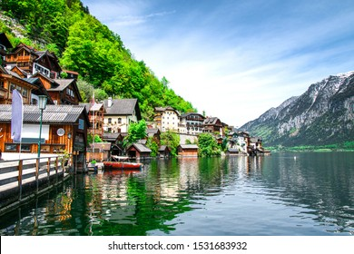 View of buildings along the coastline. View of the mountains and monuments of the city. Hallstatt, Austria.