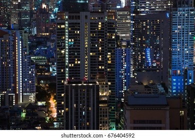 View of buildings in Bangkok city at night, detail shot of business district in city at Night